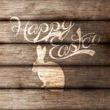 Huevos de Pascua en fondo de madera libre illustration