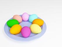 Huevos de Pascua en una placa Fotografía de archivo libre de regalías
