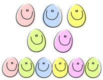 Huevos de Pascua felices de la cara de la historieta fotografía de archivo libre de regalías