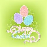 Huevos de Pascua a mano con una inscripción hermosa: Pascua feliz Imagen de archivo