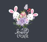 Huevos de Pascua y primavera del conejito con la flor