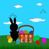 Huevos del conejito de pascua y de Pascua en la cesta, tarjeta de felicitación de Pascua Foto de archivo