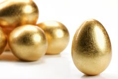 Huevos del oro Imágenes de archivo libres de regalías