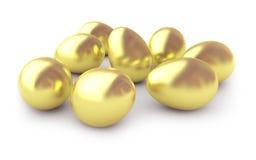 Huevos del oro fotos de archivo