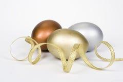 Huevos del oro, de la plata y del bronce Fotos de archivo libres de regalías