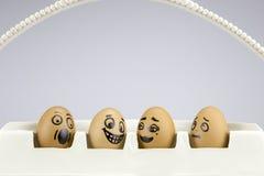 Huevos divertidos con las caras pintadas Fotografía de archivo