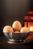 Huevos en fondo negro Imagen de archivo
