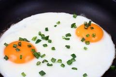 Huevos en la cacerola Fotografía de archivo libre de regalías