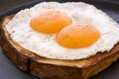 Huevos en la carne Foto de archivo