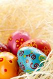 Huevos en paja Foto de archivo