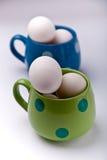 Huevos en taza Foto de archivo libre de regalías