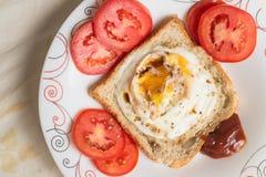 Huevos encendidos y salsa Imagen de archivo libre de regalías