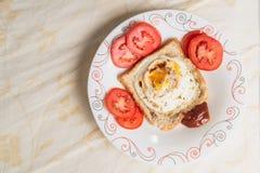 Huevos encendidos y salsa Fotografía de archivo