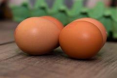 Huevos encima de una tabla Imágenes de archivo libres de regalías