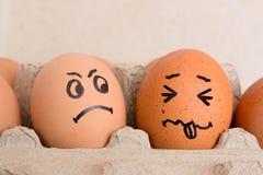 Huevos enojados y asustados de la cara Fotografía de archivo