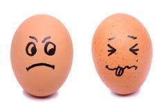 Huevos enojados y asustados de la cara Fotos de archivo libres de regalías