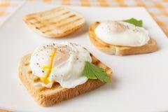 Huevos escalfados Fotografía de archivo libre de regalías