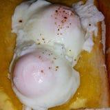 Huevos escalfados Foto de archivo