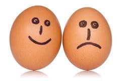 Huevos felices y enojados Foto de archivo libre de regalías