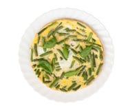 Huevos fritos con las habas verdes Foto de archivo libre de regalías