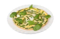 Huevos fritos con las habas verdes Fotos de archivo libres de regalías