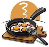 Huevos fritos con tocino Fotos de archivo