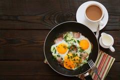 Huevos fritos con tocino Fotografía de archivo