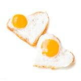 Huevos fritos del corazón Foto de archivo libre de regalías