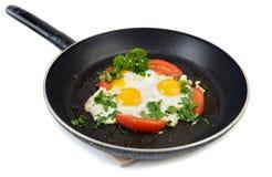 Huevos fritos en la cacerola Fotografía de archivo libre de regalías