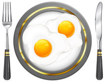 Huevos fritos en la placa Imágenes de archivo libres de regalías