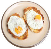 Huevos fritos en tostada imagen de archivo