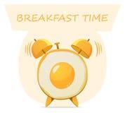 Huevos fritos y despertador Fotos de archivo