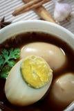 Huevos guisados o huevos y cerdo en salsa marrón Fotografía de archivo libre de regalías
