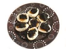 Huevos hervidos con el caviar Fotografía de archivo