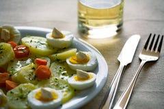 Huevos hervidos con las patatas y las zanahorias Fotografía de archivo libre de regalías