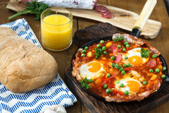 Huevos a la Flamenca or Flamenco Eggs. Eggs poached in tomato sauce. Royalty Free Stock Image
