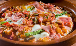Huevos a la Flamenca - Spanish baked eggs Royalty Free Stock Photography