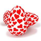 Huevos pintados con los pequeños corazones Fotografía de archivo