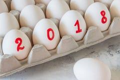 Huevos por el Año Nuevo con la inscripción 2018 Fotografía de archivo libre de regalías