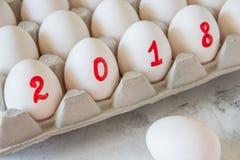 Huevos por el Año Nuevo con la inscripción 2018 Foto de archivo libre de regalías