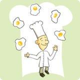 Huevos que hacen juegos malabares del cocinero Fotografía de archivo libre de regalías
