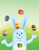 Huevos que hacen juegos malabares del conejito de pascua Foto de archivo libre de regalías