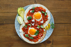 Huevos rancheros closeup on the table, horizontal view from above royalty free stock images