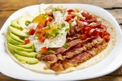 Huevos-rancheros - Eier in der Ranch lizenzfreies stockbild