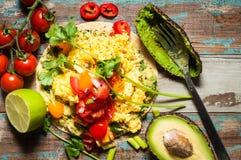 Huevos Rancheros. Home made huevos rancheros. A popular Mexican breakfast dish of eggs, tomato, avocado and chili peppers served on a corn tortilla Royalty Free Stock Photo