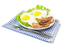 Huevos revueltos con tocino Fotos de archivo