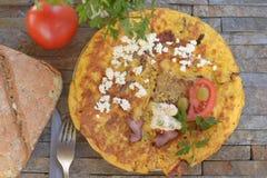 Huevos revueltos del perejil del tomatoe del pan Foto de archivo libre de regalías