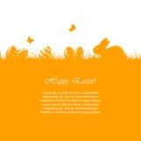 Huevos y conejo de Pascua en hierba anaranjada