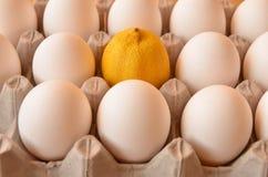 Huevos y un limón Imágenes de archivo libres de regalías
