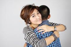 Hug. Mother hugging her teenage boy Royalty Free Stock Photo